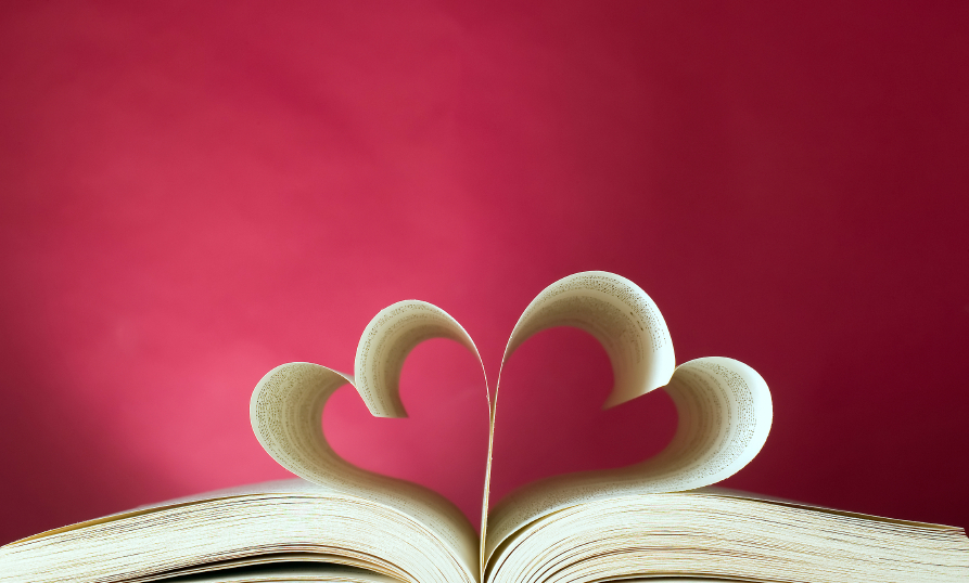Book, pages folded into a pair of hearts silhouette