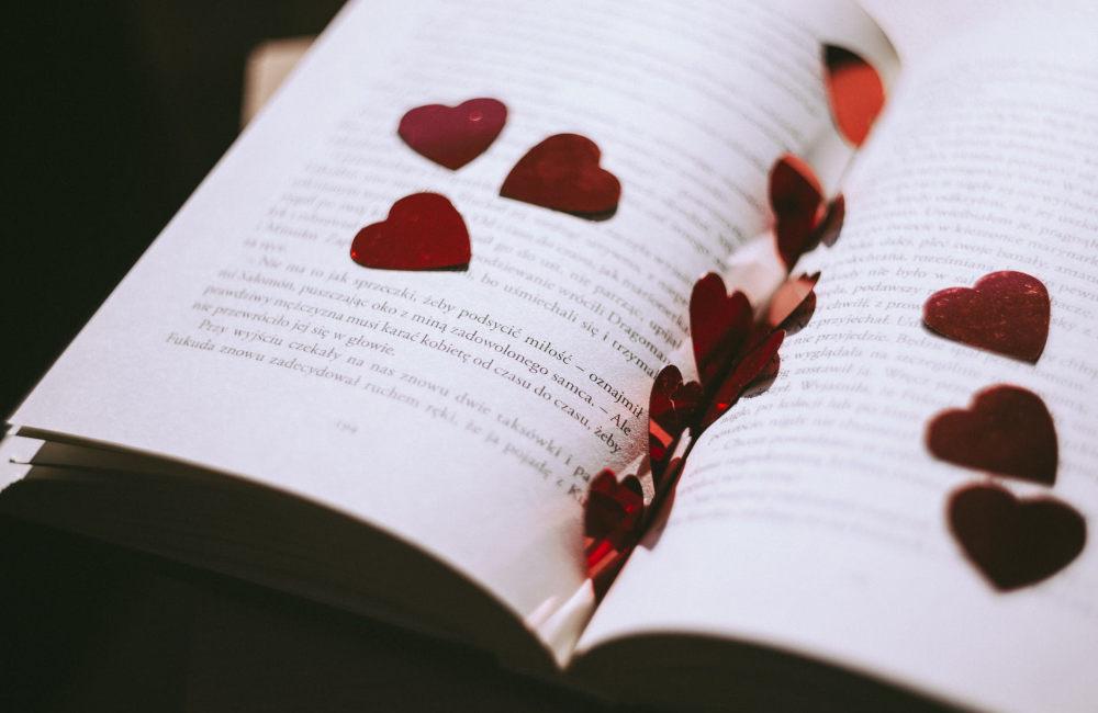 Heart-shaped petals on an open book