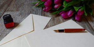 Fountain pen on stationery with tulips